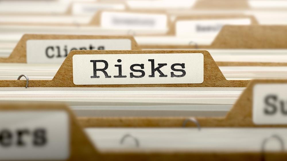 Risks Concept. Word on Folder Register of Card Index.