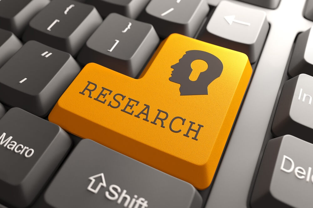 Orange Research Button on Computer Keyboard to Unlock IMT Custom Research